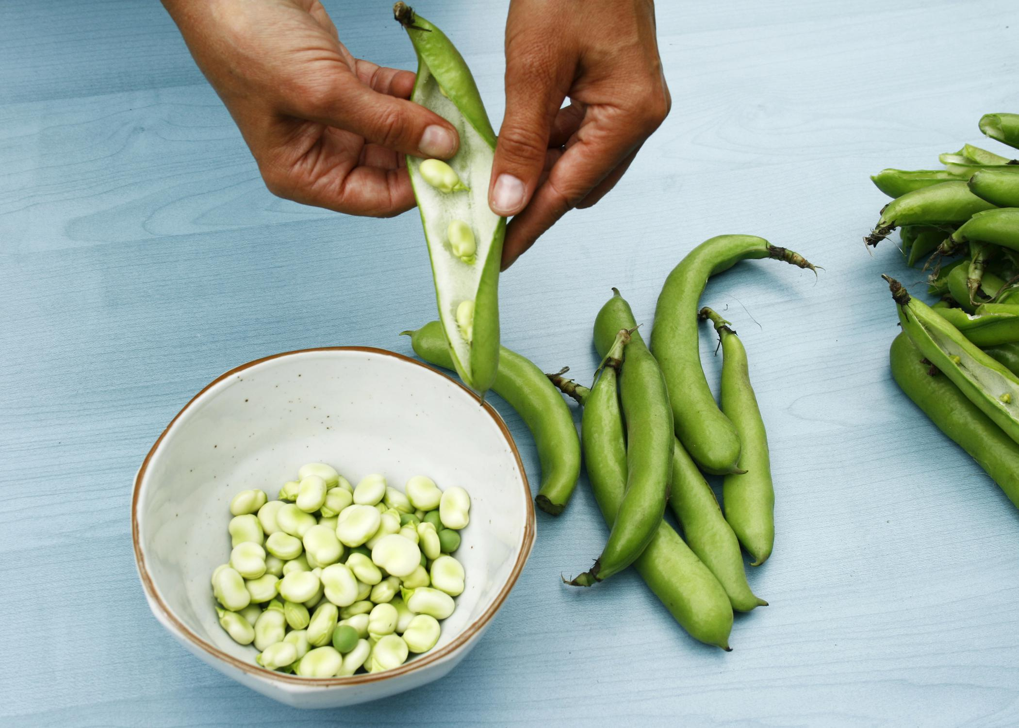 Before freezing vegetables, such as beans, shell them and then separate the good from the bad. (iStock photo)