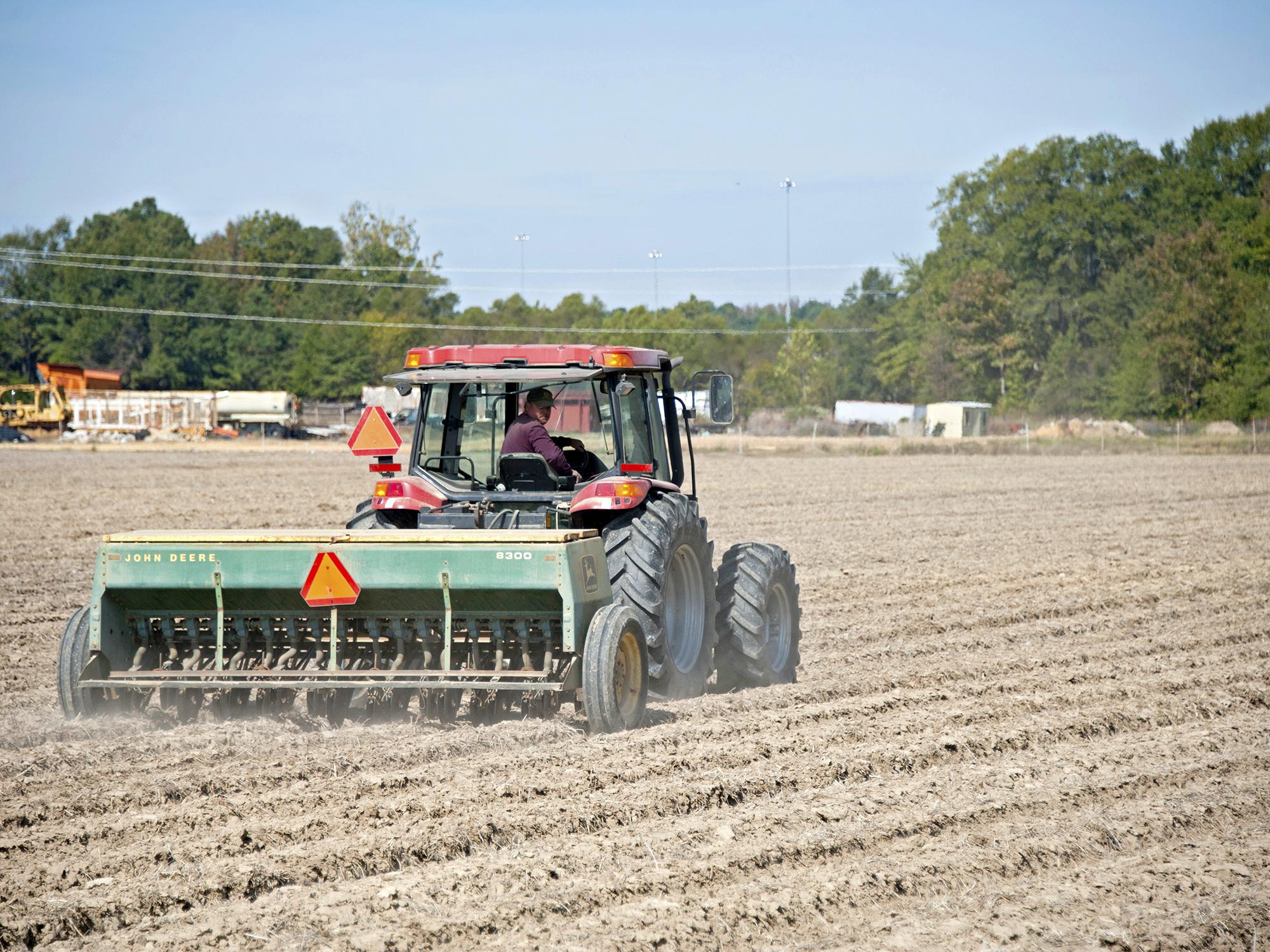 Wheat acreage is expected to be up from last year, but the ground across most of the state was too dry to plant through October. Blake Garrard is shown planting wheat last fall at the Mississippi State University Rodney Foil Plant Science Research Center in Starkville. (File photo by MSU Extension/Kat Lawrence)