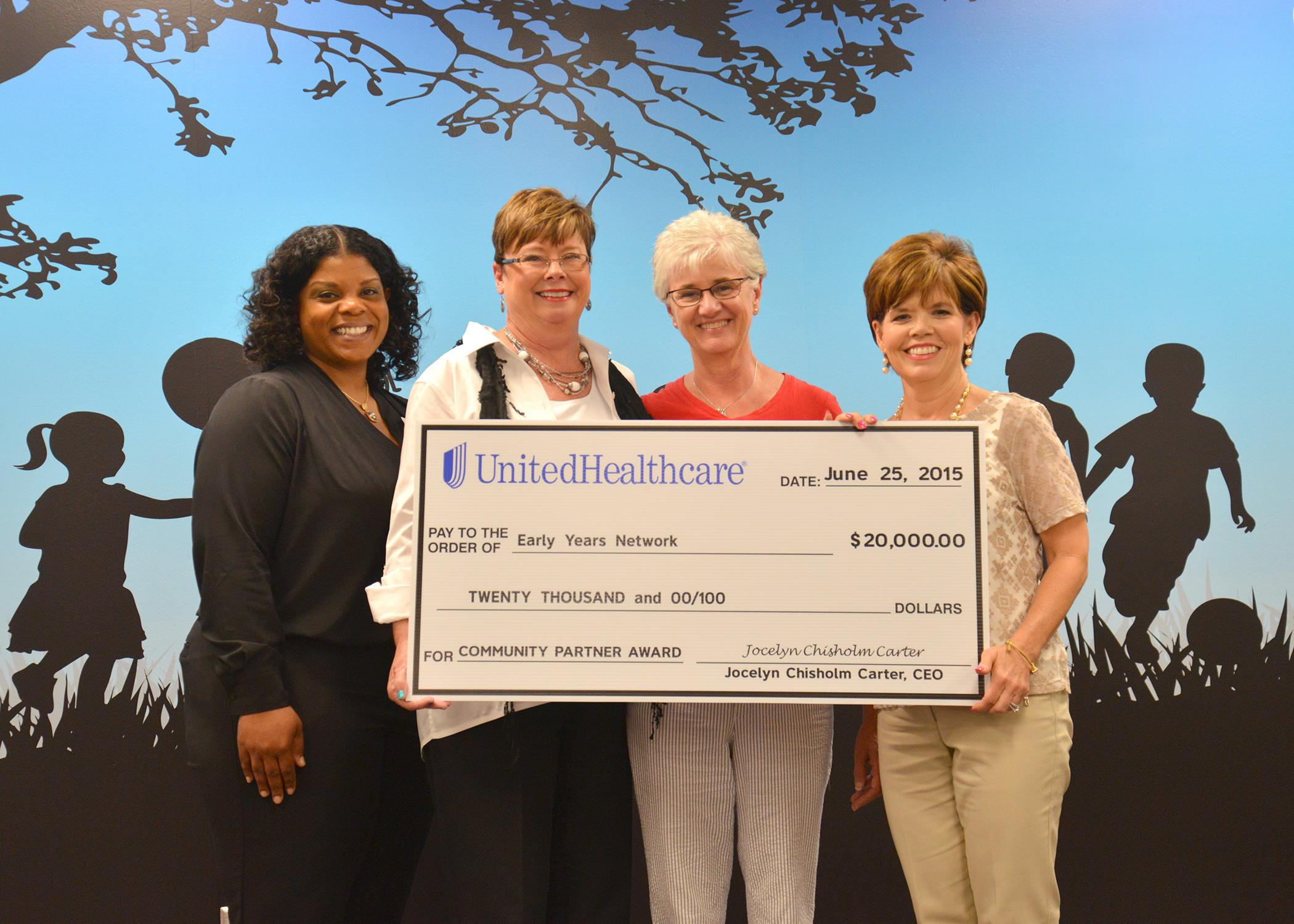 Representatives of the Early Years Network and UnitedHealthcare take part in a check presentation ceremony during the grand opening of the Hinds County Resource and Referral Center at 350 West Woodrow Wilson Avenue in Jackson, Mississippi on June 25, 2015. Celebrating their newly formed partnership are Kenisha Potter, left, pediatric health care coordinator for UnitedHealthcare; Louise E. Davis, professor with the Mississippi State University Extension Service and director of the Early Years Network; Connie