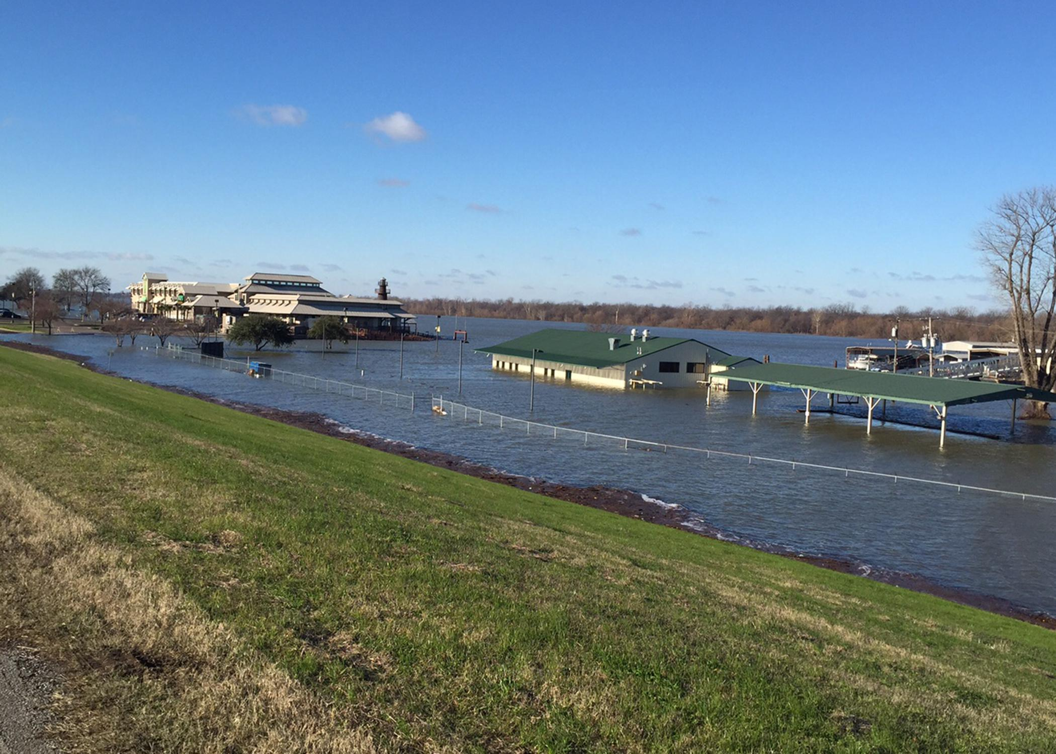 The Mississippi River set flood records in January at Greenville and points south. The flooded Greenville Yacht Club and a casino in the background are seen in this January 10, 2016, photo. (Submitted Photo by Mississippi Levee Board/Peter Nimrod)