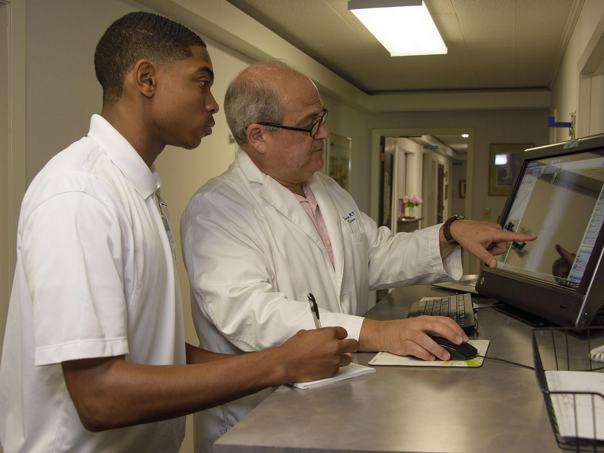 This high school student observes a family practice doctor at work during the 2016 Rural Medical Scholars summer program at Mississippi State University. Applications and program details for 2017 are available online at http://www.extension.msstate.edu/rms/. (Photo by MSU Extension Service/Kevin Hudson)