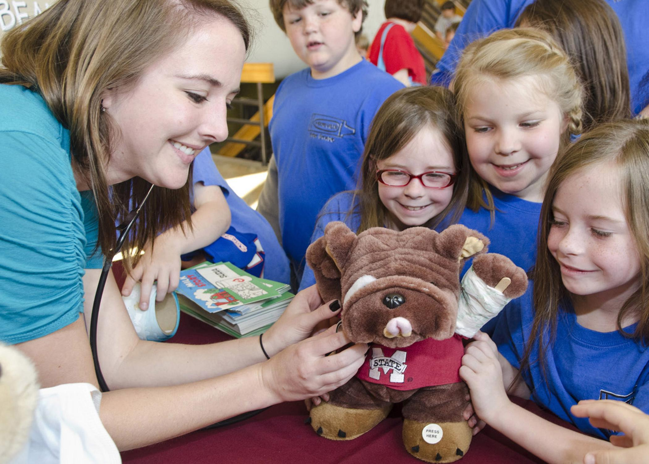 Pre-registered school groups will attend the Mississippi State University College of Veterinary Open House on April 5. Students, such as these at the 2012 event, enjoy the hands-on activities and demonstrations. (Photo by MSU College of Veterinary Medicine/Tom Thompson)