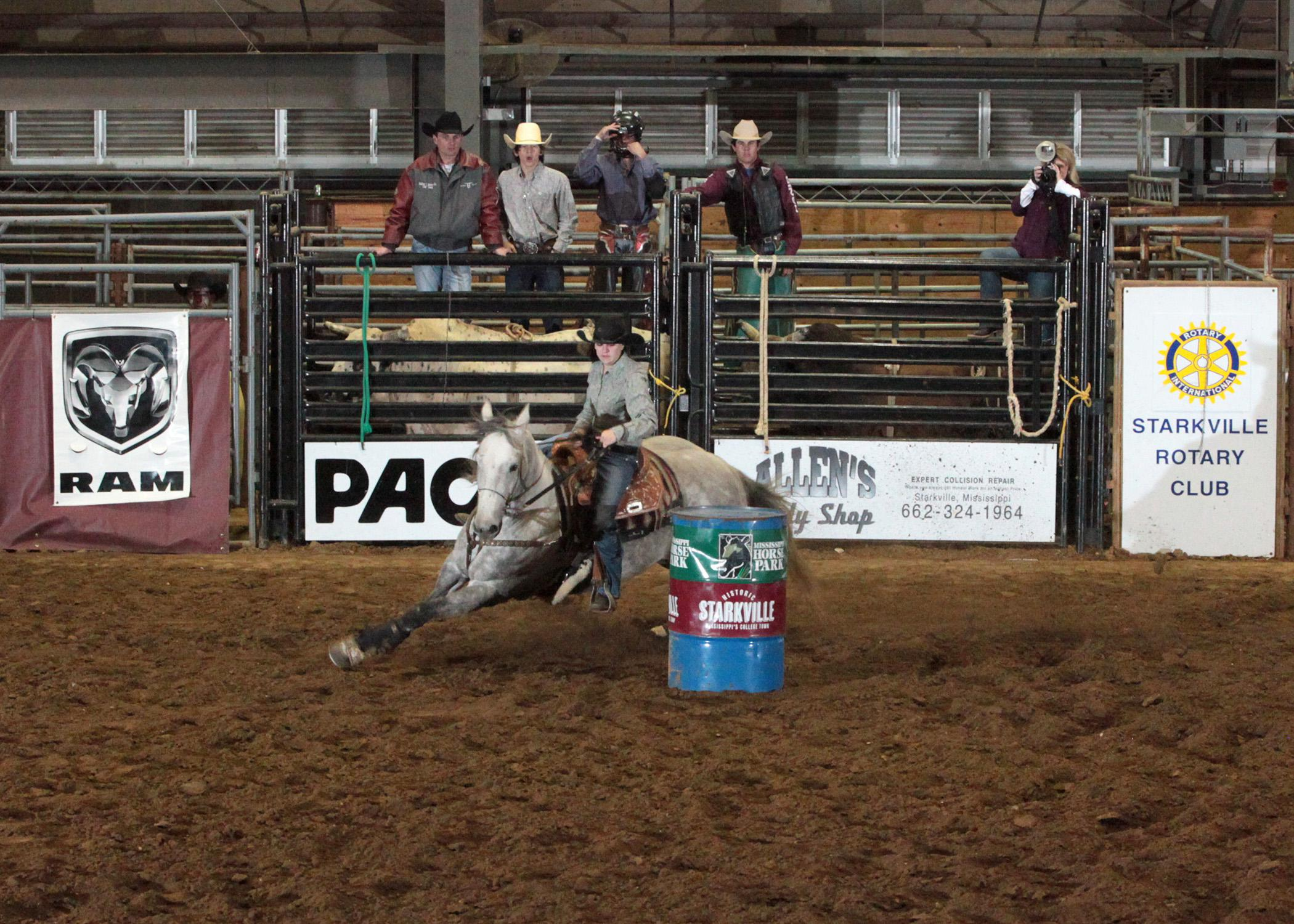 """Victoria Williams races around a barrel at the 2013 Rotary Classic Rodeo, held in February at the Mississippi Horse Park. The Mississippi State University facility near Starkville, Miss., recently earned a """"best footing"""" award from the Women's Professional Rodeo Association. (Submitted Photo)"""