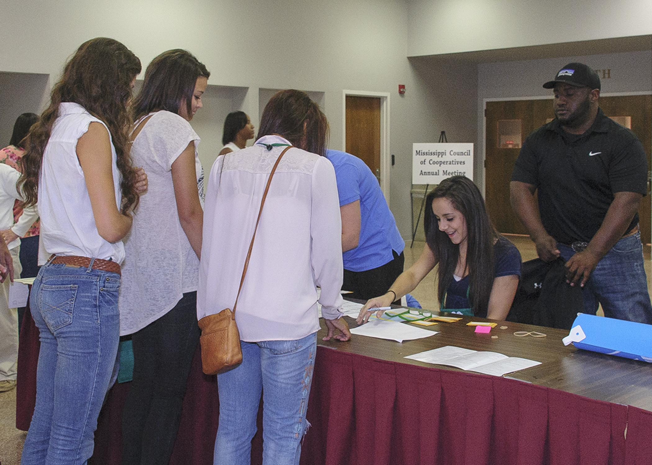 Mississippi 4-H members gathered at Mississippi State University Tuesday, July 15, 2014, for the four-day workshop and tour to learn about business cooperatives and state government. Marella Failla of Hancock County, the state 4-H Council president, helped with registration. (Photo by MSU Ag Communications/Kevin Hudson)