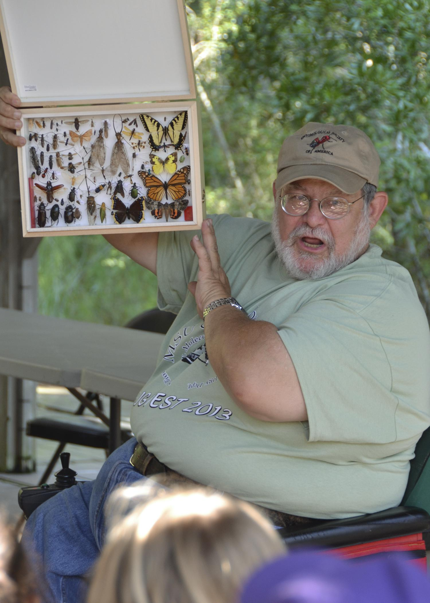 John Guyton, Mississippi State University Extension entomology specialist, shares an insect collection with a school group on Sept. 27, 2013, during Bugfest at the Crosby Arboretum in Picayune. Participants in this year's two-day event can take part in insect collection and identification, tours of the pitcher plant bog, tree identification hikes, a beekeeping tutorial and more. (Photo by MSU Ag Communications/Susan Collins-Smith)