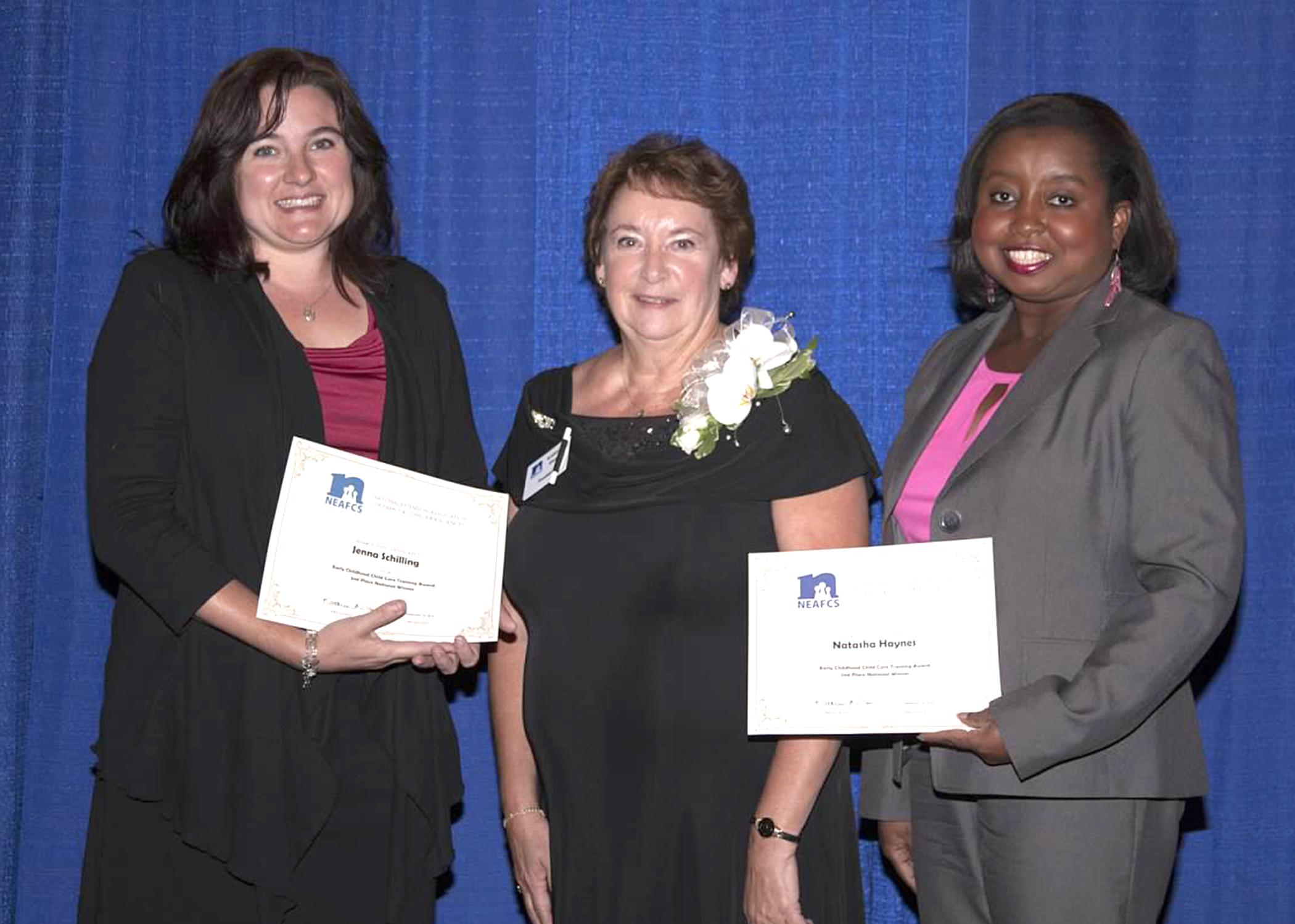National Extension Association for Family and Consumer Sciences past president Kathleen Ann Olson, center, presents Jenna Schilling, left, and Natasha Haynes with the Early Childhood Child Care Training Award for the TummySafe program at the NEAFCS Annual Conference in Lexington, Kentucky on Sept. 18, 2014. (Submitted Photo)