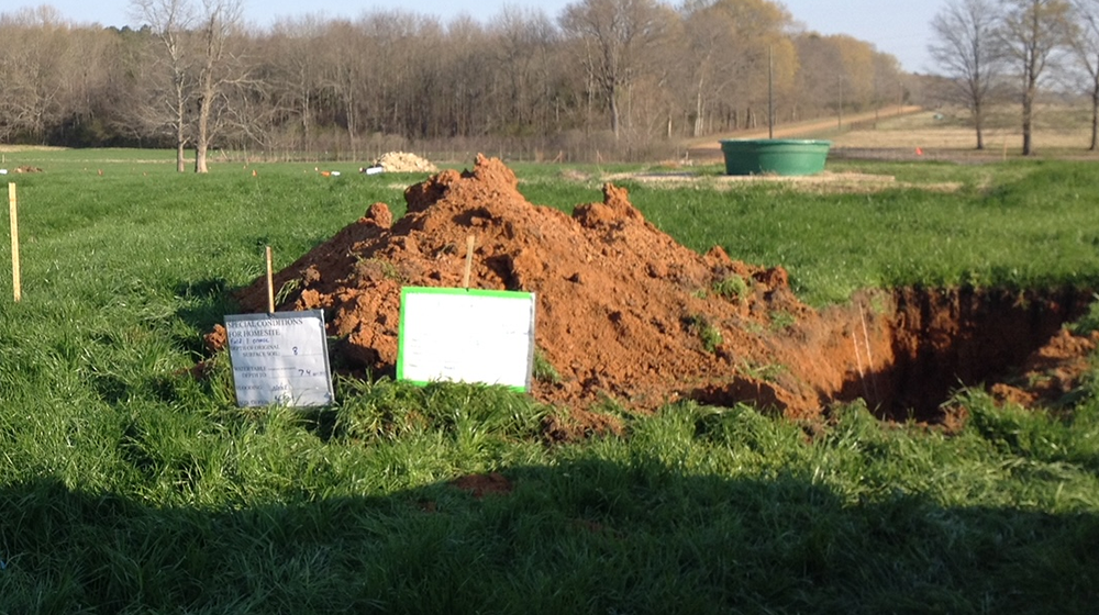 Excavated soil pits on the H. H. Leveck Animal Research Center at MSU.