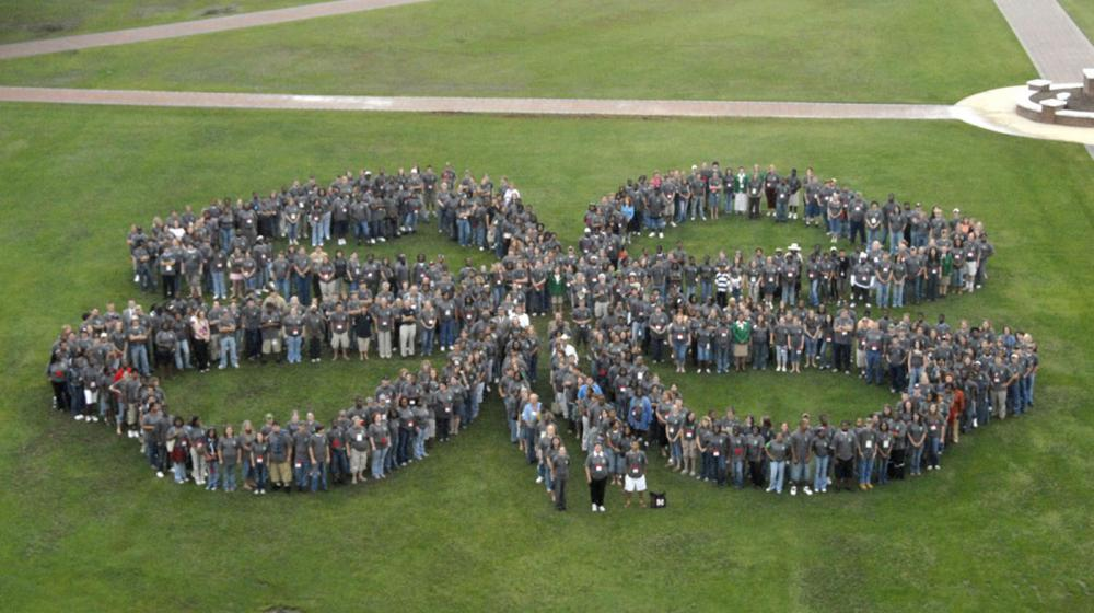 More than 600 4-H'ers gathered on the Mississippi State University campus to create a clover-leaf photograph to celebrate the 100th anniversary of 4-H in Mississippi. The perimeter of the shape was mapped out using GIS and GPS technologies.