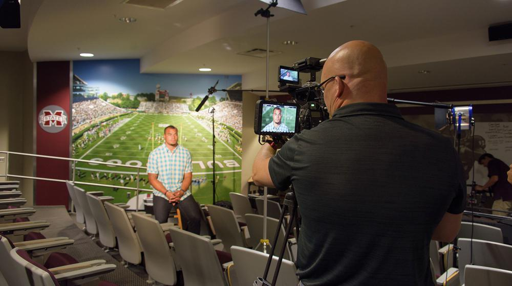 Image of Dak being filmed for colon cancer screening PSAs.