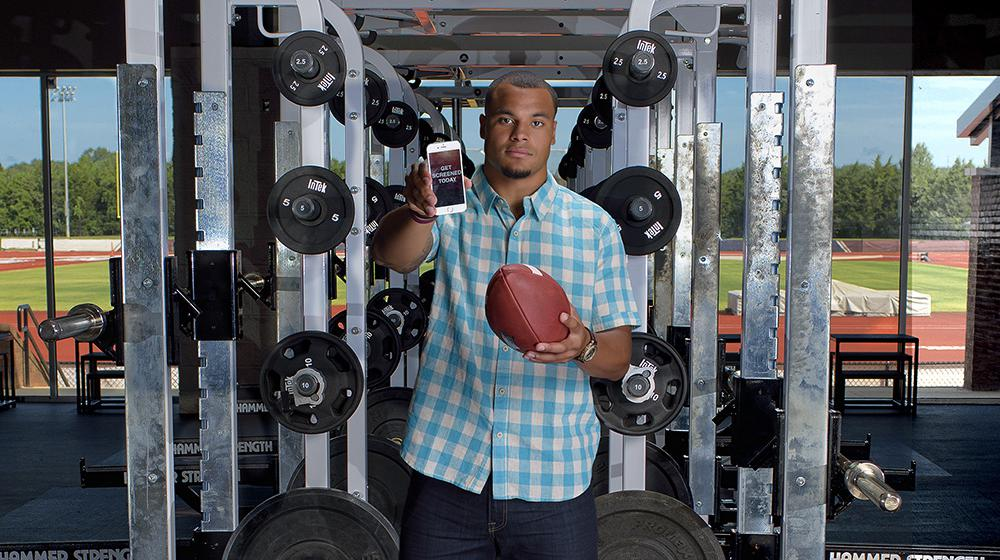 DAK holding football and phone during Colon Cancer Screening PSA shoot.