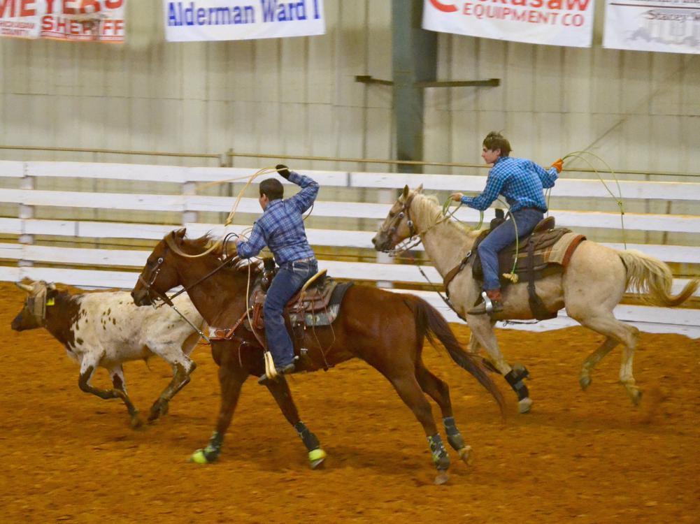 Jake Fulgham, the header, and Ty Edmondson, the heeler, take part in a team roping event at the 4-H Spring Rodeo Classic in April 2016 at the Chickasaw County Agri-Center.  (Photo by MSU Extension Service/Susan Fulgham)