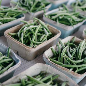 Several brown containers of green beans.