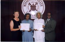 Virginia Whittington, president of the Mississippi 4-H Volunteers Association, (from left) presents a certificate for 60 years of service to Thelma Harris of Adams County and Dessie Burks of Madison County. The two volunteers were honored recently during the state 4-H Congress at Mississippi State University. Joining in the presentation is Harvey Gordon, 4-H volunteer development specialist with MSU's Extension Service.