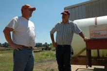 Farming award winner John Ingram, left, visits on his farm with Yalobusha County Extension Director Steve Cummings one early summer day. Both men are among several Yalobusha County residents to earn recognition for their work in agriculture.
