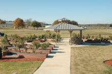 The Veterans Memorial Rose Garden is located at the Highway 182 entrance to Mississippi State University's Foil Plant Science Research Facility. In addition to use as a research and teaching facility, the rose garden is open to the public and can be scheduled for weddings and other events. (Photo by Bob Ratliff)