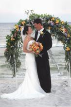Maci and Graham Flautt, who now reside in Sumner, Miss., chose a beach location for their Sept. 5, 2004, wedding in Gulf Shores, Ala. This wedding destination offered the couple all the special details of a traditional wedding, but in an untraditional setting. (Photo used with permission)
