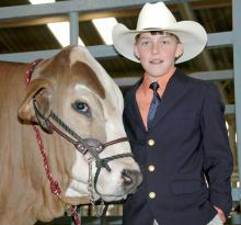 Lane Valentine, 12, of Bay Springs, sold his reserve champion Brahman steer Thursday at the Dixie National Sale of Junior Champions in Jackson. (Photo by Bonnie Coblentz)