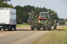 Farm machinery is seen year-round on Mississippi roads, but especially in the fall as farmers move equipment to different fields. (Photo by Marco Nicovich)