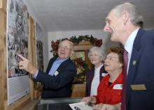Longtime 4-H advocates, from left, Don Taylor, Zona Dale Taylor, Dot Taylor and Charles Taylor admire a poster displaying historical events of the 1960s. The posters are part of an exhibit at the Mississippi 4-H Learning Center and Pete Frierson 4-H Museum in Jackson. (Photo by Tom Thompson)