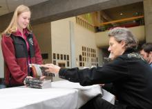 Temple Grandin signs a book Tuesday for Mississippi State University student Kristin Nichols, a member of the College of Veterinary Medicine's class of 2010. (Photo by Tom Thompson)