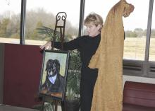 Columbus resident Terry Brewer unveils a portrait of her 15-year-old dog, Abby, that she commissioned in honor of faculty, students and staff at Mississippi State University's College of Veterinary Medicine. The portrait will hang in the Small Animal Clinic's reception area. (Photo by Tom Thompson)