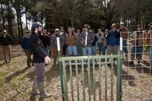 Jay Cumbee, a USDA wildlife disease biologist, teaches Mississippi State University students about proper wild pig trap door design. An effective door is critical for wild pig trapping. (Photo by Scott Corey)