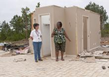 Mae Gladys Dotson, right, shows Choctaw County Extension director Juli Hughes where she sought shelter when the April 24 tornado destroyed her home. (Photo by Scott Corey)