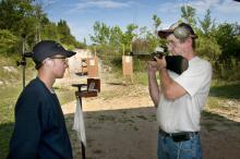 Luke South of Tishomingo County receives instruction from Coach William Baldwin at the Mississippi 4-H National Shooting Sports team practice held at the Starkville Gun Club. (Photo by Scott Corey)