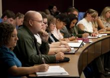 The long admissions process yields a veterinary class that becomes a family of sorts for the next four years. Rachel Smith, from left, and Christopher Karnes sit with their classmates of the Class of 2014 during a lecture. (Photo by Tom Thompson)