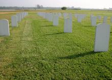 Mississippi State University completed a three-year study of how turfgrass varieties perform in cemetery settings. These fake headstones dot the turf at the research plot on MSU's R.R. Foil Plant Science Research Center. (Photo by Mississippi Agricultural and Forestry Experiment station/Wayne Philley)
