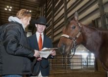 Union County 4-H youth agent Gina Wills and 4-H member Bobby May of Marshall County review the show schedule for the Winter Classic Horse Show held at the Mississippi Horse Park near Starkville. May and his horse, Jack, took part in the series of off-season shows from January through March. (Photo by Scott Corey)