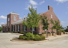 Trees planted at the east and west ends of a building, such as those at The Citizens Bank of Philadelphia branch in Starkville, provide shade and reduce energy use.