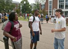 Michael Carlew (right), a senior studying landscape architecture and landscape contracting and management at Mississippi State University, talks to two other MSU students about the role landscape architects play in the environment. (Photo by MSU Ag Communications/Scott Corey)
