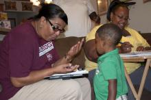 Margie Moore, left, with the Mississippi Child Care Resource & Referral Network's Project Navigator, reviews educational materials with Sherris and Curtis Grace of DeKalb.