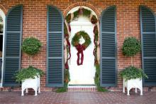 Mississippi State University president Mark Keenum and his family have a pine and magnolia wreath and garland adorning their door this holiday season. The wreath was made by Wm. Puckett, Inc. and the garland is from the Fresh Garland Company. Both items are available for purchase at The University Florist. (Photo by Kat Lawrence)