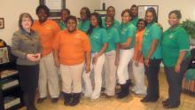 Before : Charity Womack (front row, left) wanted a healthier lifestyle so she joined other members of the Tunica County 4-H Club in the Move to Lose program, with encouragement from 4-H agent Ebony Jones (far right).