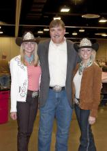 Miss Dixie National Paige Nicholson and Miss Mississippi Rodeo Samantha Golden joined Mississippi State University Extension Service director Gary Jackson at the 2012 Dixie National Sale of Junior Champions to support youth development and agriculture. (Photo by Kat Lawrence)
