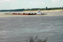 Mississippi farmers are counting on barges such as this one near the Port of Greenville on Wednesday, July 25, 2012, to continue accessing river ports to load and unload farm products. (Photo by MSU Delta Research and Extension Center/Rebekah Ray)