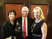 Dr. Phil Bushby (center) celebrates his Animal Welfare award from the American Veterinary Medical Association with Marcia P. Lane (left) and his wife Retha. Bushby holds the Marcia P. Lane Endowed Chair in Humane Ethics and Animal Welfare at the Mississippi State University College of Veterinary Medicine. (Submitted Photo)