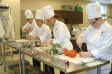 Andrew Simons, Brianna Allen, Shelby Harris and Jessica Wasmer, members of the St. Martin High School 4-H Club, prepare Gulf Coast Bouillabaisse ingredients during a practice run for the 2012 Great American Seafood Cook Off held Aug. 12 in New Orleans. (Photo by MSU Ag Communications/Susan Collins-Smith)