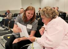 Casey Coleman of Tupelo and Patricia Pendergrass of Louisville review the agenda while waiting for the beginner beekeeper workshop to begin Friday, Oct. 26, 2012, at the annual Mississippi Beekeepers Association conference, held at Mississippi State University. (Photo by MSU Ag Communications/Keri Collins Lewis)