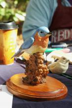 Artist and woodcarver John Houston carved and painted figurines, such as this bird, out of Water Tupelo wood and basswood for sale at the Piney Woods Heritage Festival held Nov. 16 and 17 at Mississippi State University's Crosby Arboretum. (MSU Ag Communications/Susan Collins-Smith)