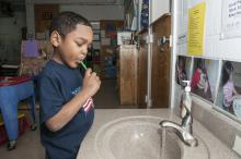 Mississippi State University Aiken Village Preschool student Deshaun Phillips brushes his teeth to prevent cavities and maintain good dental hygiene on Feb. 18, 2013. (Photo by MSU Ag Communications/Scott Corey)
