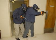Two law enforcement agents practice clearing a Mississippi State University hallway during an active-shooter response course on March 15, 2013. MSU's Extension Service coordinated the three-day course developed and facilitated by the National Center for Biomedical Research and Training, one of the leading training agencies for U.S. Department of Homeland Security initiatives. (Photo by MSU Ag Communications/Linda Breazeale)