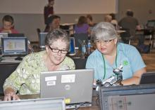 Volunteer and professional robotics instructors spent five days at Mississippi State University increasing their skills in robotics programming. From left, Tiffany Lowrey of the Tishomingo County Career and Technical Center and Evelyn DeAngelo of the MSU Extension Service in Jackson County test their robot with Tim Friez, Carnegie Mellon University software engineer, on Aug. 14, 2013. (Photo by MSU Ag Communications/Kat Lawrence)