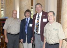 Rep. Scott Bounds, from left, Jerry Belant and Bruce Leopold of the Mississippi State University Center for Human-Wildlife Conflicts, and Sen. Giles Ward took part in the Mississippi Legislative Wild Hog Summit on Sept. 9, 2013, in Jackson, Miss. (Photo by MSU Ag Communications/Linda Breazeale)
