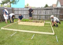 """Gary Bachman, horticulture expert with Mississippi State University, provides guidance to the """"Ask This Old House"""" crew, including (from left) producer Heath Racela, landscape contractor Roger Cook, director Thomas Draudt and grip Sean Finnegan. The traveling home improvement show filmed the installation of a backyard high tunnel in Biloxi on Oct. 9. (Photo by MSU Ag Communications/Susan Collins-Smith)"""