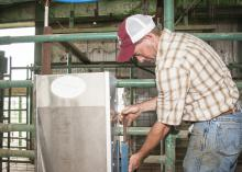 William White works to install pig-handling equipment in a multipurpose building being readied for swine nutrition research at Mississippi State University's H.H. Leveck Animal Research Center. (Photo by MSU Ag Communications/Scott Corey)