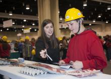 Jessica Graves of Mississippi State University's Animal and Dairy Sciences Department explains the different cuts of beef and pork to David Eisman, an eighth-grader at Bayou View Middle School, during Mississippi's first Pathways2Possibilities career expo in Biloxi Nov. 13. The event introduced 19 different career paths, including agriculture, to eighth-graders from 27 public, private and home schools in the six coastal counties. (Photo by MSU Ag Communications/Kat Lawrence)