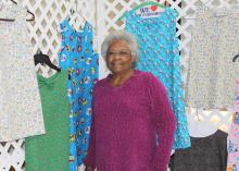 Helen Coleman, president of the Bolivar County Mississippi Homemaker Volunteers, gathers dresses created by her club to send to children in need for the MHV International Project. (Photo by MSU Ag Communications/Keri Collins Lewis)